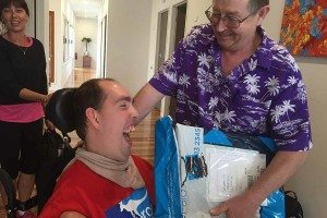 Nick receiving his new communication device at the Wooloowin Share House