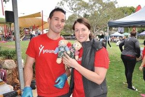 Sarah Paget with her partner holding up two teddy bears