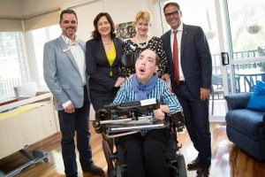 Nick Thorley in his room at the Youngcare Share House at Wooloowin with Premier Palaszczuk.