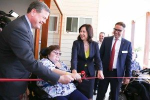 Youngcare-housemate-Trina-cutting-the-ribbon-with-Annastacia-Palaszczuk