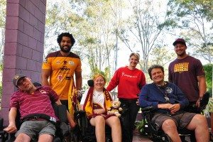 Sam Kennerley with Broncos players Adam Blair and James Gavet, and residents Greig, Hazel and Ryan