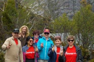 Youngcare-cradle-mountain-trekkers-in-front-of-the-lake-and-trees