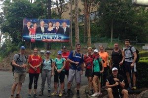 Simpson Desert 2016 trekkers in front of Channel 9 sign at Mt Cooth-tha