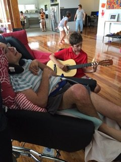 Playing guitar at the Share House
