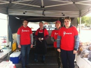 Four Youngcare volunteers at a Bunnings BBQ