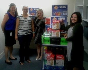 Danielle Arlott (HSF), Michelle Davie, Courtney Phelps and Nicki Ogaard-Stephans (Youngcare) packing the rations for the trek