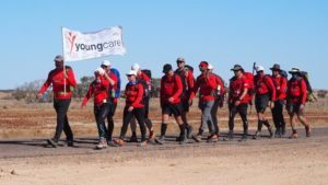 SDC trekkers holding the Youngcare flag
