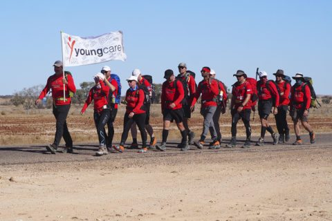 SDC trekkers 2017 walking into Birdsville with the Youngcare flag